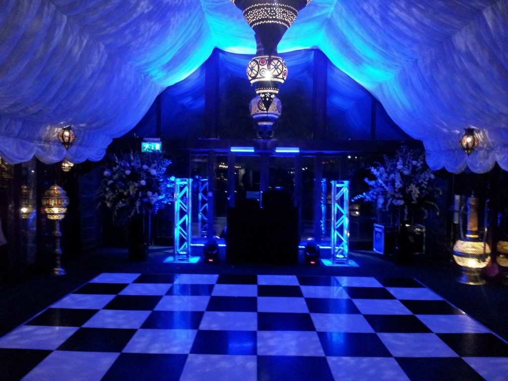 DJ equipment and blue lighting to show Live Events Group disco set up